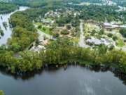 A drone image of the Rotary Wheel Garden from over Greenfield Lake. The Amphitheater is at lower left.